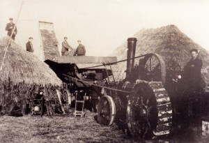 A team of men operating a threshing machine at Preston